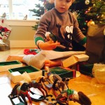 inspecting his dad's hallmark rocking horse collection